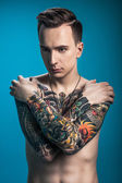 Stylish man with tattoos — Stock Photo