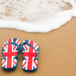 Stock Photo: Flip-flops on the Beach