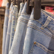Jeans on Shop Rail — Stock Photo