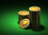 Small group of gold poker chips on green — Stock Photo