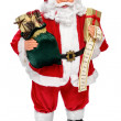 Santa Claus doll with presents and name list — Stock Photo