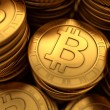 Close up 3D illustration of paneled golden Bitcoins — Stock Photo