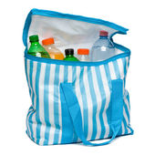 Open blue striped cooler bag with full of cool refreshing drinks — Stock Photo