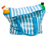 Closed blue striped cooler bag with full of cool refreshing drin — Stock Photo