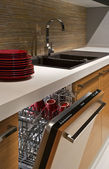 Modern kitchen with dishwasher — Stock Photo