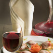 Stock Photo: Still life with glass of wine and gourmet dinner