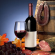 Still life with wine and sausages - Stock Photo