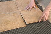 Master stick floor tiles — Stock Photo