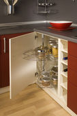 Detail of a circular open kitchen cabinet with cans of beans — Стоковое фото