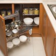Detail of open kitchen cabinet with cans of beans — Foto Stock