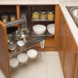 Detail of open kitchen cabinet with cans of beans — Photo