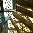 Staircase with wrought iron railing — Stock Photo