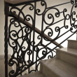 Stock Photo: Staircase with wrought iron railing