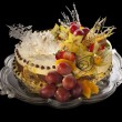 Stock Photo: Mousse cake decorated with fruits