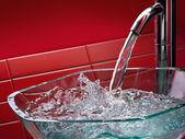 Modern glass bathroom sink — Stock Photo