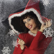 Pretty young woman in Santa Claus clothes — Stock Photo