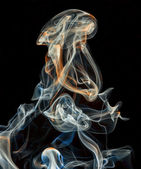 Abstract colored smoke isolated on a black background — Stock Photo