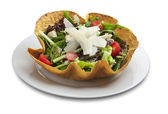 Vegetable salad in tortilla bowl shape with cheese — Stock Photo