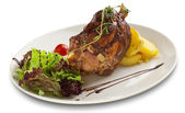 Pork knuckle ,baked meat with curly cabbage — Stock Photo