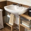 Detail of a modern bathroom with sink and accessories — Stock Photo #43657673