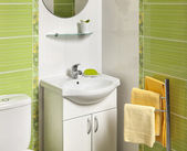 Detail of a green modern bathroom with sink — Stock Photo