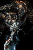 Color abstract smoke isolated black background — Stock Photo