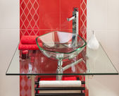 Detail of a modern bathroom interior in pink and white with sink of glass — Stock Photo