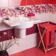Detail of a modern bathroom with floral motif tiles and accessor — Stock Photo #45063367
