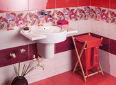 Detail of a modern bathroom with floral motif tiles and accessor — Stock Photo