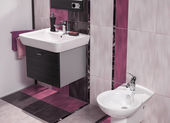 Detail of modern bathroom with sink and bidet — Stock Photo