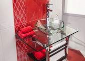 Interior of modern bathroom with glass sink — Stock Photo