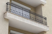Detail of building and decorative metal railing window — Stock Photo