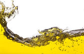 Abstract image of a yellow liquid spilled. On a white background — Stock Photo