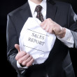 Royalty-Free Stock Photo: Businessman Holding Sales Report