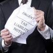 Royalty-Free Stock Photo: Businessman Holding Tax Notice