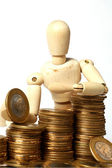 Doll with coins — Stock Photo
