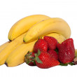 A bunch of bananas and a strawberries isolated on white — Stock Photo