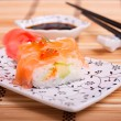 Sushi with salmon and red caviar — Stock Photo