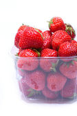 Juicy strawberries in a container — Stock Photo