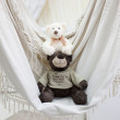 Toy bear on white swing — Stock Photo