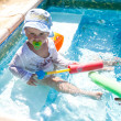 Happy boy in waterpool — Stock Photo