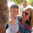 Happy mother with cute baby boy having vacation — Foto Stock