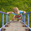 Happy little boy walking up on ladder — Stock Photo