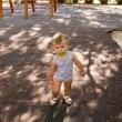 Little blond boy near forest lake on summer evening — Stock Photo #34400279