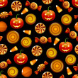 Vector de stock : Halloween candy seamless pattern with pumpkins