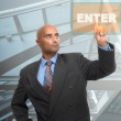 Businessman pointing to an enter button — Stock Photo #23440388