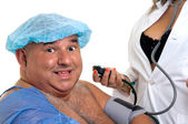 Large happy male patient with sexy doctor — Stock Photo