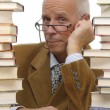 Mature man with books — Stok fotoğraf