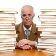 Mature man surounded by books - Foto Stock