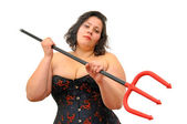 Beautiful large young woman with devil's fork isolated in white — Stock Photo